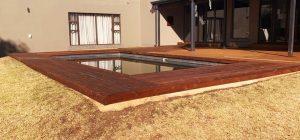 Everlast Pine Decking wooden floor around the pool area
